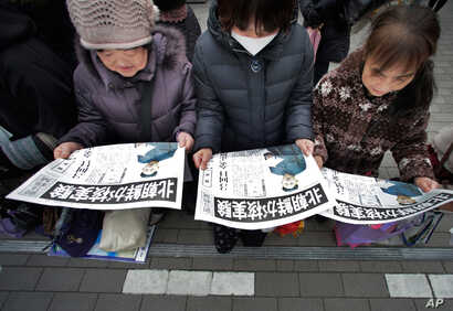 An extra edition of a Japanese newspaper were delivered in Tokyo, reporting North Korea's nuclear test February 12, 2013.