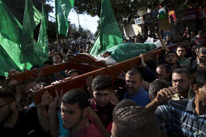 Palestinians carry the body of Mousab Abu Leila, during his funeral after the 29-year-old was killed during a protest on the border with Israel, in Gaza City, May 14, 2018.