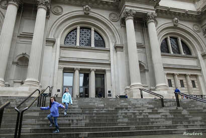 Children run down the stairs of The Metropolitan Museum of Art in New York, October 2012.