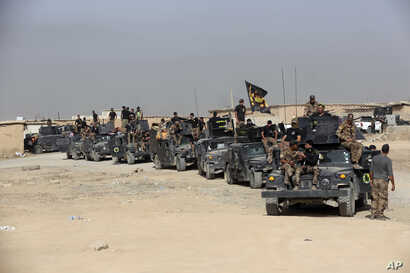 Iraq's elite counterterrorism forces gather ahead of an operation to retake the Islamic State-held city of Mosul, outside Irbil, Iraq, Oct. 15, 2016.