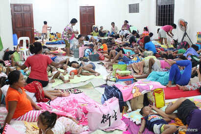 People are seen inside an evacuation center in preparation for Typhoon Mangkhut in Cagayan, Philippines, Sept. 13, 2018, photo from social media.