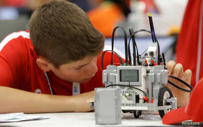 A participant from Canada prepares his miniature robot during the World Robotics Olympiad at a convention center in San Rafael,  Alajuela, Costa Rica, Nov. 10, 2017.