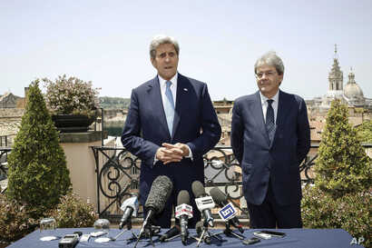 U.S. Secretary of State John Kerry, left, is flanked by Italian Foreign Minister Paolo Gentiloni, during a press conference that followed their meeting in Rome, Sunday, June 26, 2016