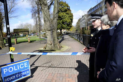 Britain's Prime Minister Theresa May is accompanied by Wiltshire Police Chief Constable Kier Pritchard and Salisbury MP John Glen, as she views the area where former Russian double agent Sergei Skripal and his daughter were found critically ill, in S...