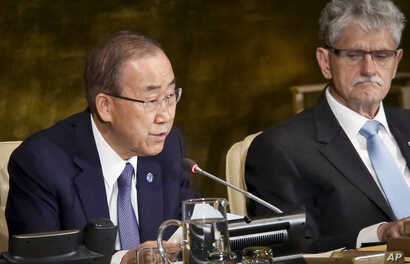 President of the U.N. General Assembly Mogens Lykketoft, right, listens as U.N. Secretary-General Ban Ki-moon address the opening of a high-level meeting on ending AIDS, June 8, 2016.