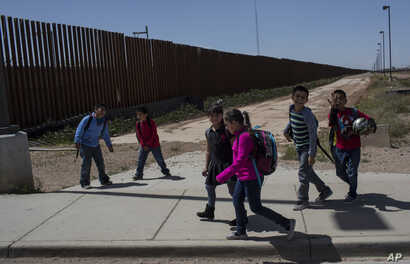 Columbus Elementary School students, cross the border from Columbus, New Mexico, U.S., into Palomas, Mexico, after a day of school, March 31, 2017.