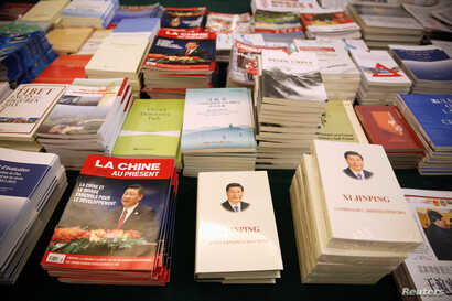 FILE - Magazines and books, featuring Chinese President Xi Jinping on the cover, are seen at the media centre during the China's National People's Congress (NPC) in Beijing, March 7, 2018.