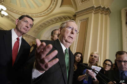 Senate Majority Leader Mitch McConnell of Ky., joined at left by Sen. John Barrasso, R-Wyo., speaks with reporters after meeting with Vice President Mike Pence as Republicans roll out their Obamacare replacement plan, March 7, 2017.