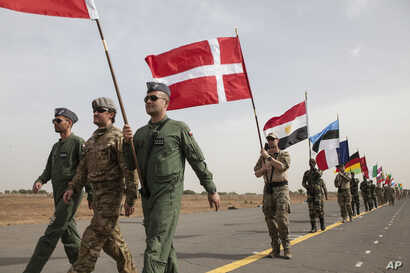 Flag bearers carry flags representing different countries taking part in the opening ceremony of Flintlock, anti-terrorism training in Thies, Senegal, Feb. 8, 2016.