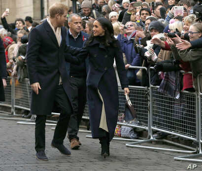 Britain's Prince Harry and his fiancee Meghan Markle arrive at the Terrence Higgins Trust World AIDS Day charity fair, in Nottingham, England, Friday, Dec. 1, 2017.