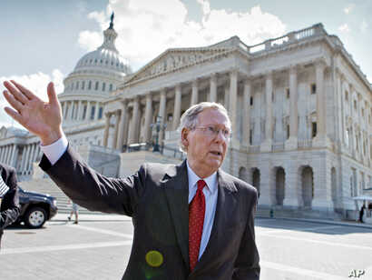 FILE -Senate Majority Leader Mitch McConnell of Kentucky, stands outside of the U.S. Capitol in Washington, July 23, 2013.