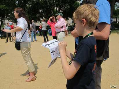 Grant Pennock, 9, consults a cheat sheet to identify some of the aircraft in the Arsenal of Democracy Flyover in Washington, D.C., May 8, 2015. He and his family are spending an academic year in Washington but otherwise live in Michigan.