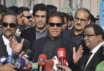 "Pakistan's opposition leader, Imran Khan, center, speaks to reporters in Islamabad, Jan. 2, 2018. Khan criticized U.S. President Donald Trump on Jan. 3 as ""ignorant and ungrateful"" after the U.S. leader accused it of harboring terrorists."