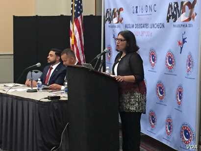 A delegate addresses the AMDC Luncheon at the Pennsylvania Convention Center during the Democratic National Convention.