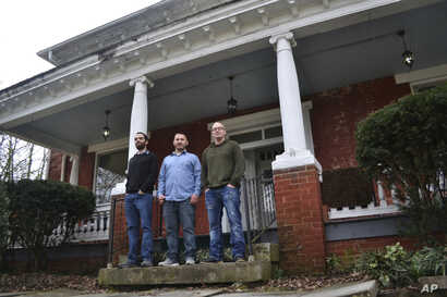Three men who are covered under Medicaid at a residential treatment program in Catlettsburg, Kentucky, a state that receives $2.35 for every $1 it sends to the federal government.