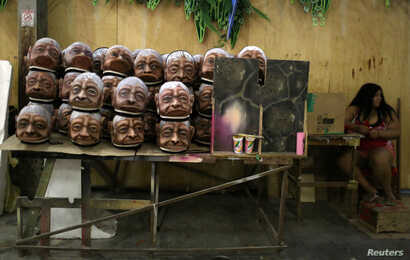 Parts of carnival floats from Imperatriz Leopoldinense samba school, depicting native people from the Amazon jungle, are seen at the school's carnival production headquarters in Rio de Janeiro, Brazil, Feb. 9, 2017.