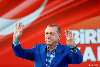 Turkey's President Tayyip Erdogan greets people at the United Solidarity and Brotherhood rally in Gaziantep, Turkey, Aug. 28, 2016.