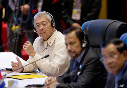 Philippines Secretary of Foreign Affairs Perfecto Yasay, left, who was standing in for Philippine's President Rodrigo Duterte attends the ASEAN-U.S. summit, a parallel summit in the ongoing 28th and 29th ASEAN Summits and other related summits at Nat...