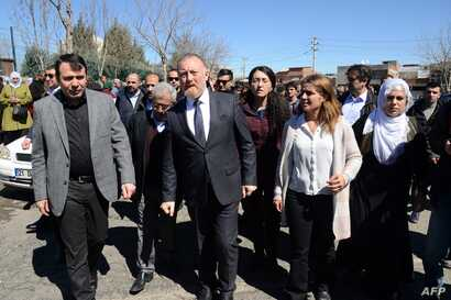 FILE - Co-leader of the pro-Kurdish Peoples' Democratic Party (HDP), Sezai Temelli, center, attends Kurdish activist Zulkuf Gezen's funeral in the Turkish city of Diyarbakir, March 18, 2019.