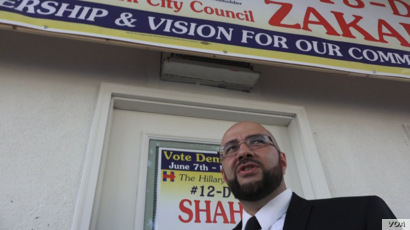 Khairullah at his political headquarters on North Eighth Street.  He is not up for reelection this year, but he is canvassing for council candidates that share his vision for the town. (Photo: R. Taylor / VOA)