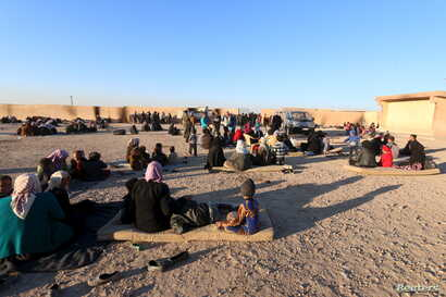 Displaced families, fleeing violence in Aleppo city and from Islamic State-controlled areas in Raqqa and Deir al-Zor, sit at a school in al-Mabroukeh village in the western countryside of Ras al-Ain, Syria, Dec. 28, 2015.