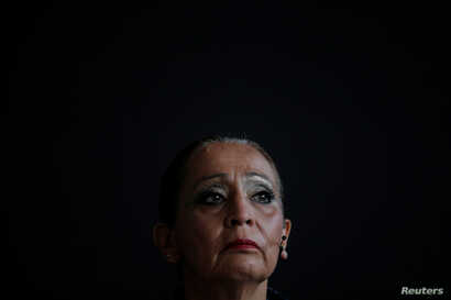 """LaDonna Brave Bull Allard, a member of the Standing Rock Sioux Tribe who protested the planned Dakota Access oil pipeline, waits to speak after being honored as a Disobedience Award finalist during """"Defiance!"""" at Massachusetts Institute of Technology..."""