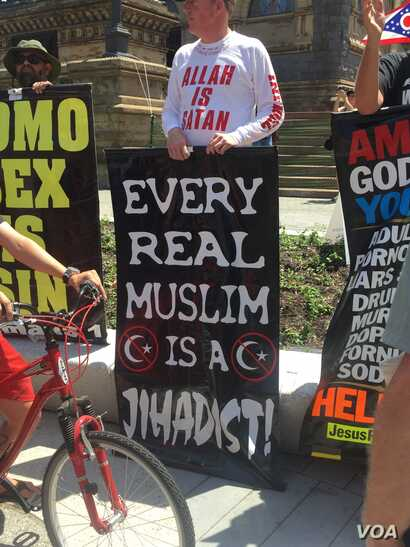 Jim Gilles of Evansville, Indiana, said he is a born-again Christian and joined a small group of people from around the country protesting Islam, in the Public Square in downtown Cleveland, July 18, 2016. The Republican National Convention, being hel...
