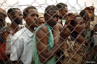 Ethiopia migrant workers seeking jobs in Saudi Arabia are being turned back on March 16, 2012, in Haradh, a town in western Yemen near the site where the Saudi government is erecting a fence along the border. (Reuters)