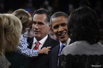 U.S. President Barack Obama and Republican presidential nominee Mitt Romney greet family members following the final U.S. presidential debate in Boca Raton, Florida October 22, 2012.