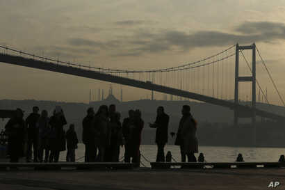 People stand by the Bosporus Strait in Istanbul, Jan. 4, 2017.  These days, with a string of terror attacks targeting Istanbul still fresh in his memory, some residents say they are changing their daily routines.