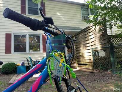 A bike awaits a 17-year-old refugee at the Ralbovsky home in Greenbelt, Maryland. The couple plan to take their foster son to the nearby farmers' market and summer music festivals if the U.S State Department approves his travel to the U.S. (A. Arab...
