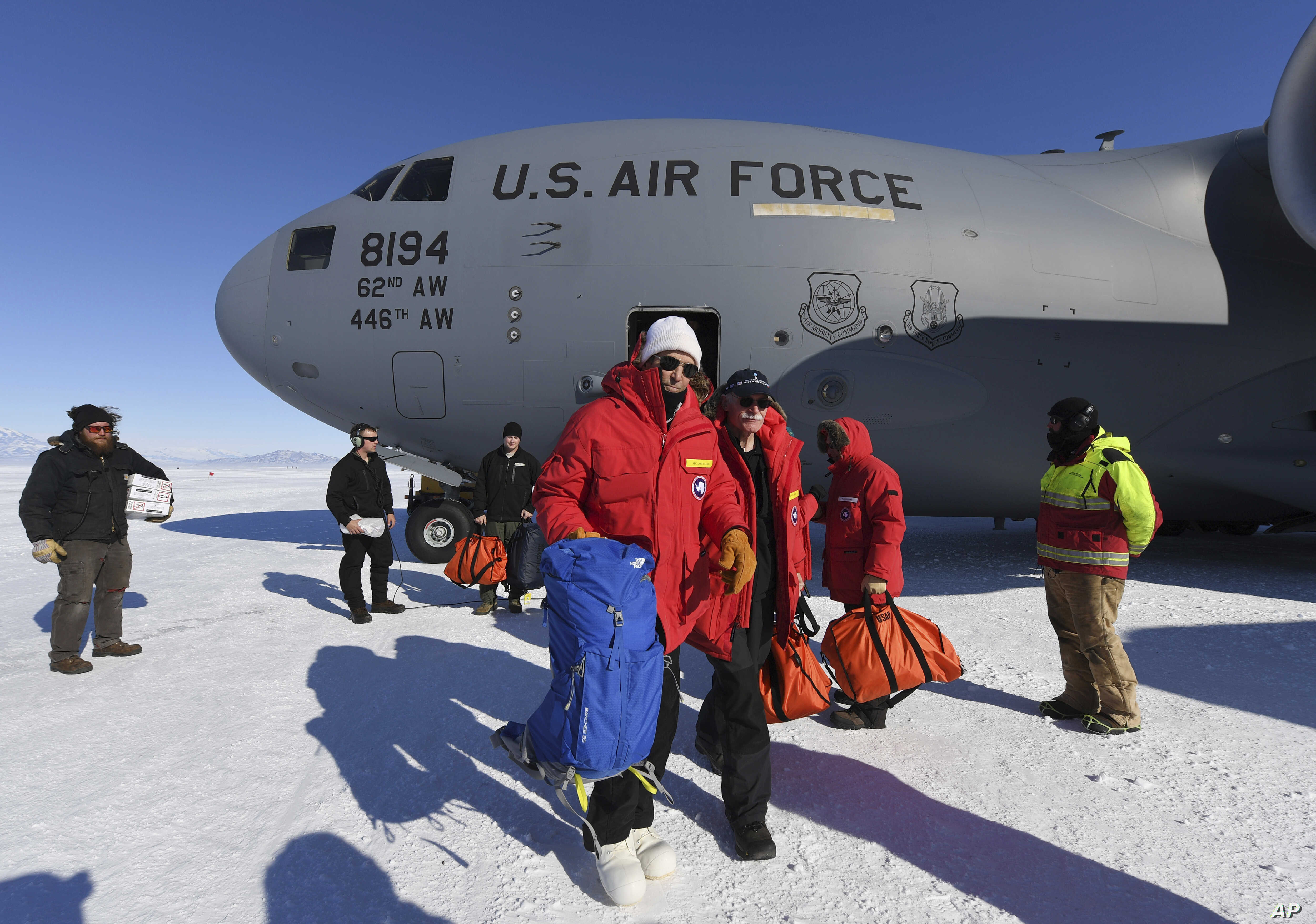 Secretary of State John Kerry, center, disembarks from a U.S. Air Force C17 Globemaster  in Antarctica on Friday, Nov. 11, 2016. Kerry holds the record for the most countries visited while secretary of state.