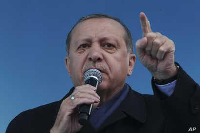 Turkey's President Recep Tayyip Erdogan gestures as he delivers his speech, during a rally for the upcoming referendum, in his hometown city of Rize, in the Black Sea region, Turkey, Monday, April 3, 2017.