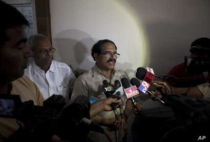 Jaganmohan Reddy, father of Alok Madasani, an engineer who was injured in the shooting Wednesday night in a crowded suburban Kansas City bar, speaks to the media at his home in Hyderabad, India, Feb. 24, 2017.