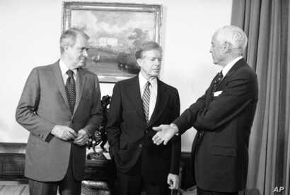 FILE - U.S. Ambassador to the USSR, Thomas Watson (R), who was recalled consultation after the Soviet military intervention in Afghanistan, talks with President Jimmy Carter and Secretary of State Cyrus Vance (L) at the White House in Washington, Jan...