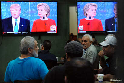 People watch the U.S. presidential debate in a restaurant