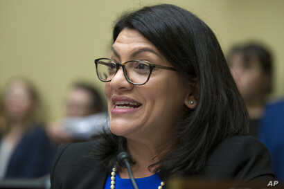Rep. Rashida Tlaib, D-Mich., questions Michael Cohen, President Donald Trump's former lawyer, as he testifies before the House Oversight and Reform Committee, on Capitol Hill, Feb. 27, 2019, in Washington.