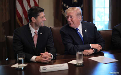 U.S. President Donald Trump talks with House Speaker Paul Ryan (R-WI) as he in the Cabinet Room of the White House in Washington, Nov. 2, 2017.