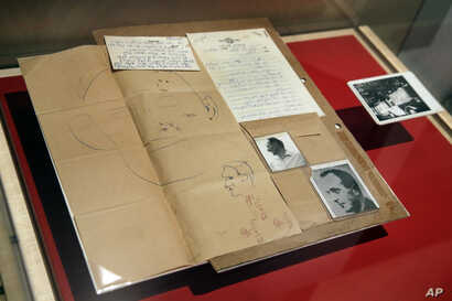 "The 1960 forensic crime lab file comparing photos of Adolf Eichmann in World War II and as Ricardo Klement in Argentina are displayed in the ""Operation Finale: The Capture & Trial of Adolf Eichmann"" exhibit at the Museum of Jewish Heritage in New Yor..."