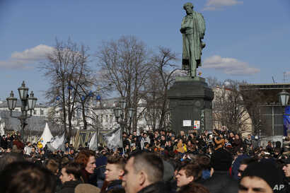 People gather outside Alexander Pushkin monument in downtown Moscow, March 26, 2017.