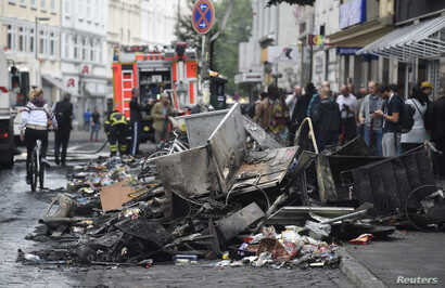 Damages are seen on a street after demonstrations at the G-20 summit in Hamburg, Germany, July 8, 2017.