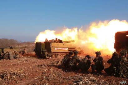 This undated picture released from North Korea's official Korean Central News Agency (KCNA) on January 5, 2015 shows a firing contest of Korean People's Army artillery units, which North Korean leader Kim Jong-Un inspected, at an undisclosed location...