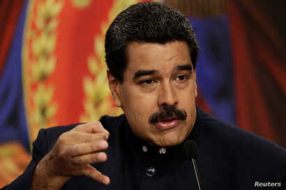 Venezuelan President Nicolas Maduro talks to reporters during a news conference at Miraflores Palace in Caracas, Aug. 22, 2017.