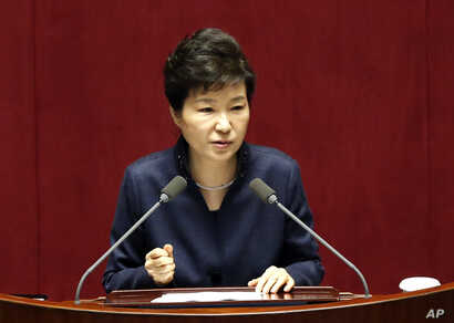 FILE - South Korean President Park Geun-hye delivers a speech at the National Assembly in Seoul, South Korea, following North Korea's recent nuclear test and long-range rocket launch.