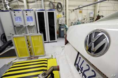 FILE - A 2013 Volkswagen Passat with a diesel engine is evaluated at the California Air Resources Board emissions test lab in El Monte, Calif.