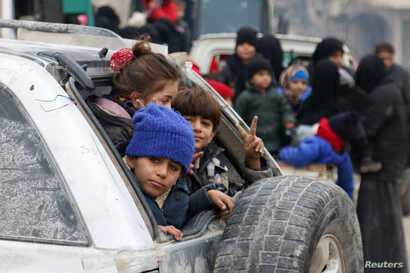 Children sit in a car as they wait to be evacuated from a rebel-held sector of eastern Aleppo, Syria Dec. 16, 2016.