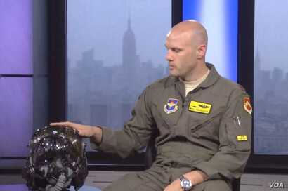 """Major Will """"D-Rail"""" Andreotta describes the $400,000-plus pilot's helmet for the F-35 fighter jet."""