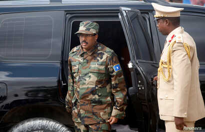 Somali President Mohamed Abdullahi Mohamed arrives for celebrations to mark the 57th anniversary of the Somali National Armed Forces in the capital Mogadishu, April 12, 2017.