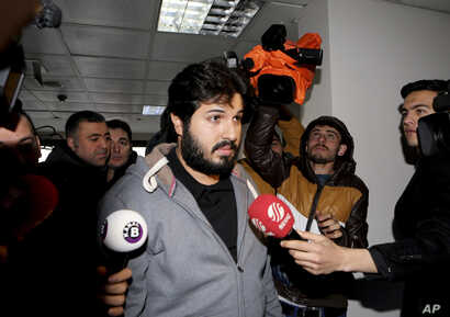 FILE - Turkish-Iranian businessman Reza Zarrab, charged in the U.S. with allegedly evading sanctions on Iran, is surrounded by reporters as he arrives at a courthouse in Istanbul, in a separate case against him, Dec. 17, 2013.