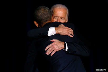 U.S. President Barack Obama is joined onstage by Vice President Joe Biden after his farewell address in Chicago, Illinois, Jan. 10, 2017.